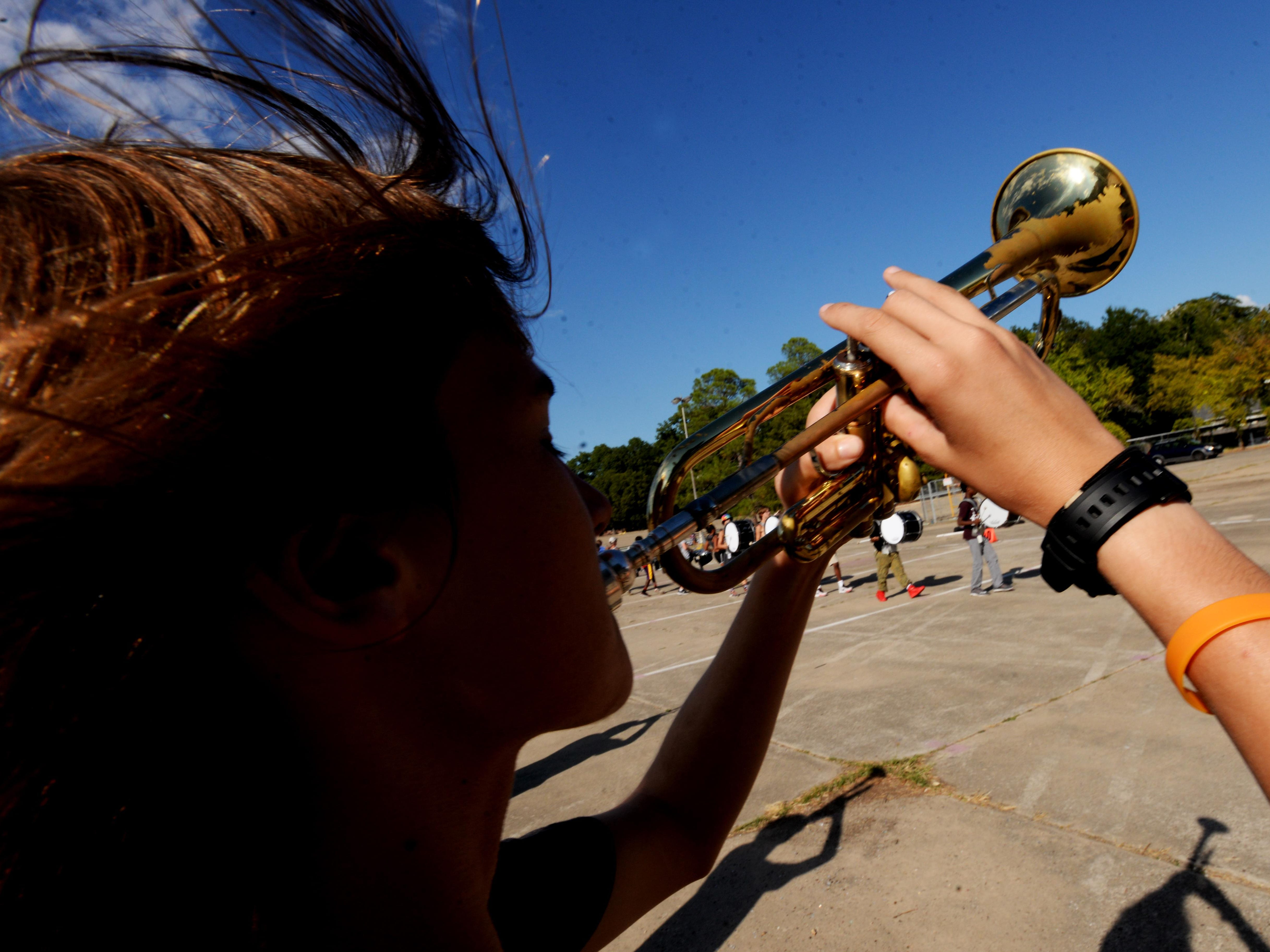 Byrd's marching band member Daven Jones plays the trumpet while at practice at the St. Vincent Mall's parking lot.