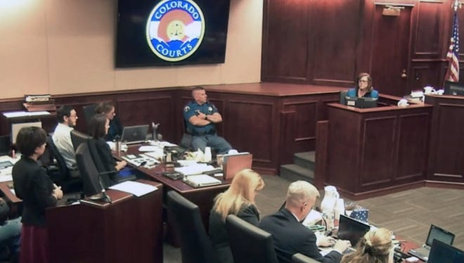 In this image made from Colorado Judicial Department video, Arlene Holmes, top right, the mother of James Holmes, second from left, in white shirt, gives testimony during the sentencing phase of the Colorado theater shooting trial in Centennial, Colo., on Wednesday, July 29, 2015. Once they begin deliberating on the sentence, the Holmes jury will be charged with deciding if Holmes is to be executed, or if any mitigating evidence, such as mental health issues, warrants instead life in prison.