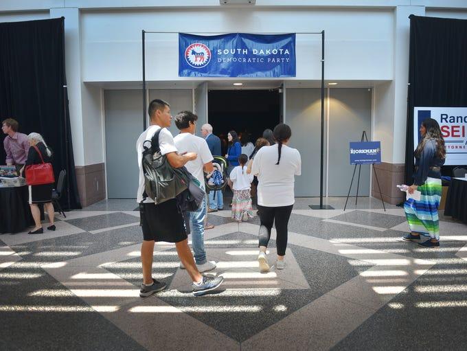People walk into the South Dakota Democratic Convention