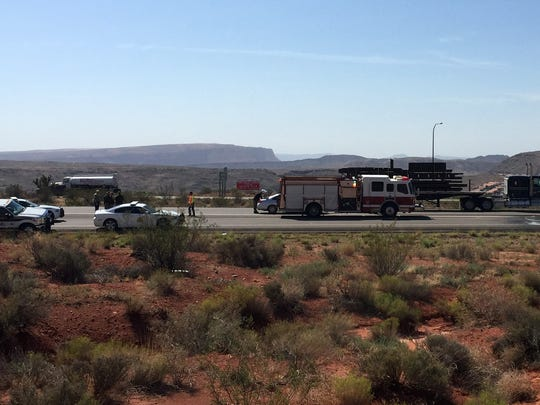 Utah Highway Patrol troopers investigate the scene on Interstate 15 near Exit 13 where a man was found in very critical condition lying in the southbound lanes of the freeway Tuesday, Aug. 18, 2015.