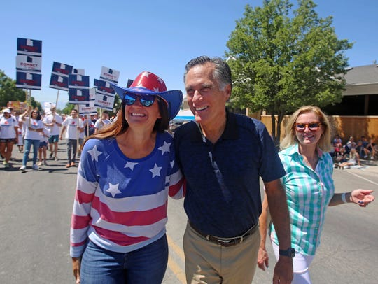 A supporter, left, poses for a photograph with Mitt