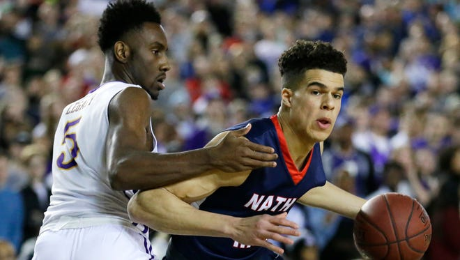 Garfield's Jaylen Nowell (left) defends against Nathan Hale's Michael Porter Jr. during the Class 3A boys state championship game last month in Tacoma.