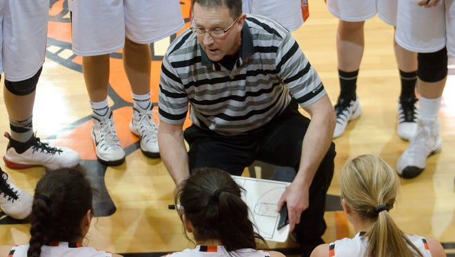 Dell Rapids coach Jeff Dvorak instructs his team Tuesday, Jan. 17, during a timeout against West Central at Dell Rapids.