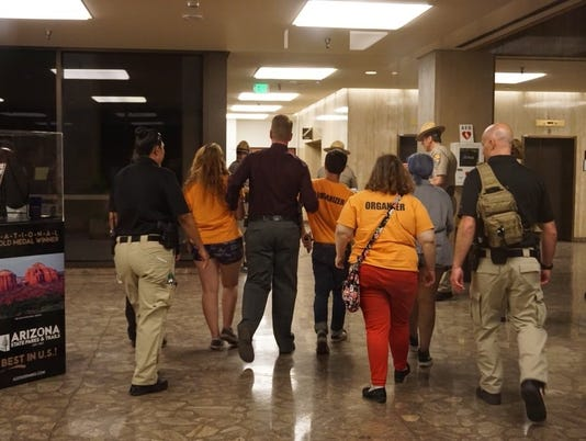 DPS escorts students our Arizona Executive Tower