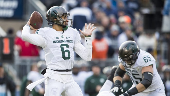 Michigan State Spartans quarterback Damion Terry passes the ball during the first quarter against the Penn State Nittany Lions on Nov. 26, 2016 at Beaver Stadium in University Park, Pennsylvania.