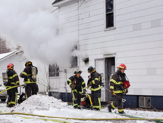 St. Cloud firefighters extinguish a fire at a home