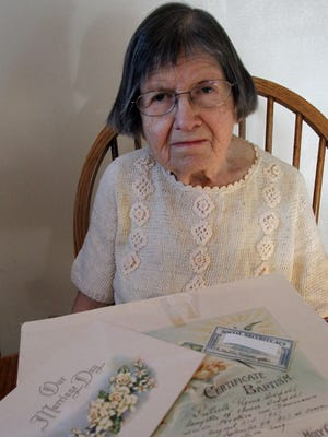 Ruthelle Frank of Brokaw sits in her home with some of her identifying documents that were not good enough to get her a state ID.