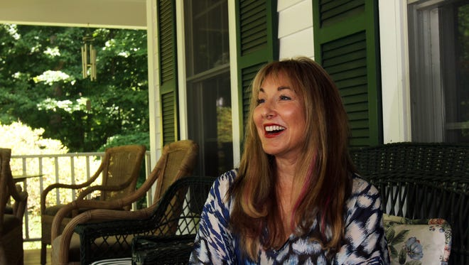 Country music singer Joanna Mosca talks about her singing career while sitting on the front porch of her Bedford home June 26, 2014.