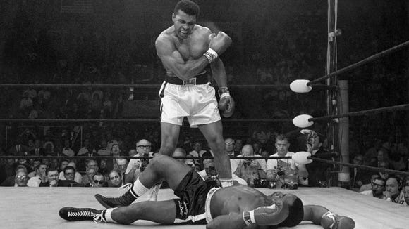 Muhammad Ali stands over fallen challenger Sonny Liston, shouting and gesturing shortly after dropping Liston with a short hard right to the jaw on May 25, 1965, in the first minute of the first round of the heavyweight fight. Ali died in 2016.