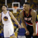 Portland Trail Blazers' C.J. McCollum (3) drives to the basket as Golden State Warriors' Draymond Green (23) defends during the first half in Game 1 of a second-round NBA basketball playoff series, Sunday, May 1, 2016, in Oakland, Calif. (AP Photo/Marcio Jose Sanchez)