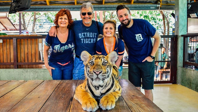 Julie and Ed Dobersek and their daughter, Mollie Dobersek and fiance Brandon Rittger traveled to Phuket, Thailand to Tiger Kingdom in February 2016. They are photographed with a 4 month old male Tiger cub. Julie and Ed live in Canton. Mollie grew up in Canton and now lives in Houston with Brandon. On the trip, Brandon proposed to Julie and she said yes.