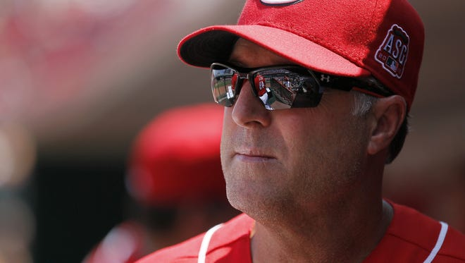 Reds manager Bryan Price looks on from the dugout during the top of the eighth inning Wednesday against the Phillies.