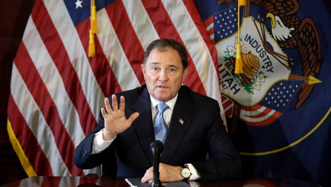 In this Feb. 5, 2015, file photo, Utah Gov. Gary Herbert speaks to reporters during a news conference at the Utah State Capitol in Salt Lake City. A federal judge has reversed an earlier decision and ruled Utah can cut off federal funds to the state Planned Parenthood organization. The ruling from U.S. District Judge Clark Waddoups on Tuesday, Dec. 22, temporarily upholds  Herbert's order to end contracts for sex education and sexually transmitted disease testing programs.  (AP Photo/Rick Bowmer, File)