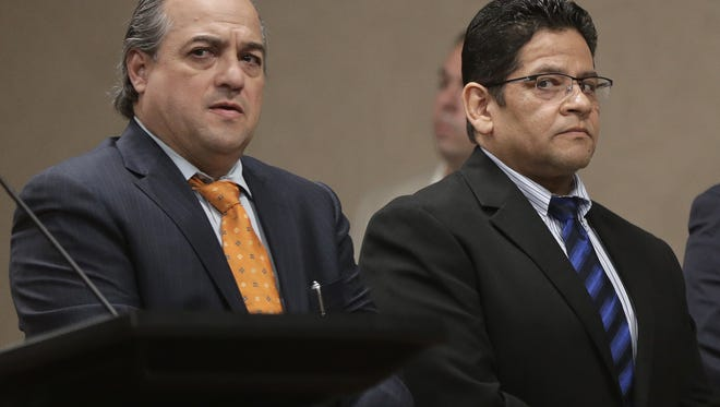 Former Deputy Raymundo Carranza, right, looks out of the corner of his eye as the jury reads a guilty verdict in his intoxicated manslaughter trial Monday in the 409th District Court. Carranza was convicted in the fatal 2012 hit-and-run of Richard Lopez on Spur 601. Carranza's attorney, Ray Gutierrez, is at left.