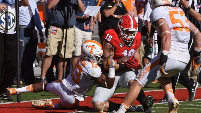 Tennessee defensive back Malik Foreman takes down Georgia tight end Isaac Nauta (18) during the first half  at Sanford Stadium Saturday, Oct. 1, 2016 in Athens, Ga.  (