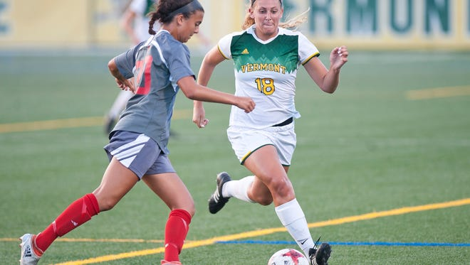 University of Vermont defender Casey Garfinkel, right, closes down a Sacred Heart player during Friday night's women's soccer game at Virtue Field.