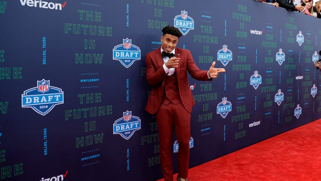 Louisville's Jaire Alexander poses for photos on the red carpet before the first round of the NFL football draft, Thursday, April 26, 2018, in Arlington, Texas. (AP Photo/Eric Gay)