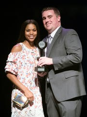 Fort Myers High School's Destanni Henderson accepts The News-Press 2018 Girls Basketball Player of the Year award from sports writer Adam Regan at the Southwest Florida Sports Awards last May.