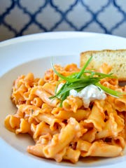 A pasta dish from Louie's Wine Dive is shown.
