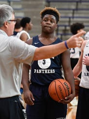 Reitz's Mar'Quan Givens listens to head coach Mike