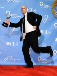 Ben Bailey poses with him  Emmy at the 38th Annual