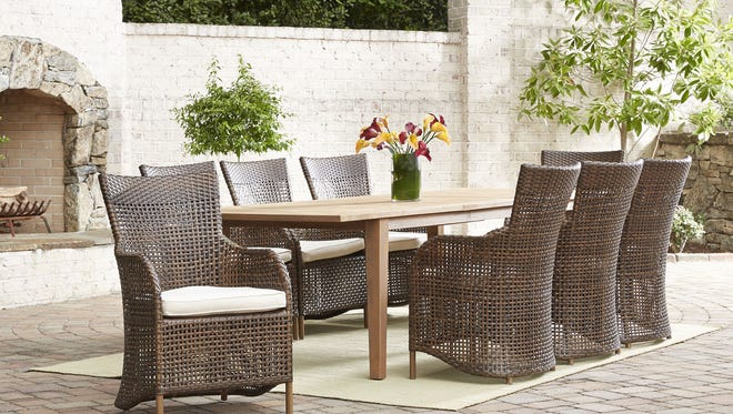 The Lloyd Flanders Havana dining group comes with eight armchairs, perfect for large outdoor gatherings.