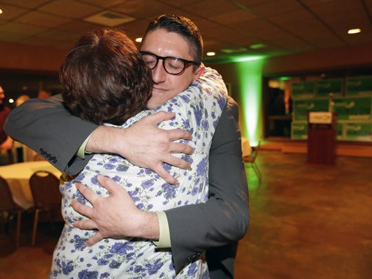 Appleton mayoral candidate Josh Dukelow gets a hug from his mother, Jeani Dukelow, after conceding to Mayor Tim Hanna Tuesday at Fox Banquets & Rivertyme Catering in Appleton.