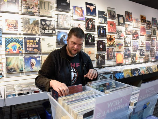 Music specialist Jeff Pederson looks through the new
