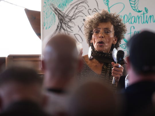 Fania Davis speaks during a panel discussion on non-violence