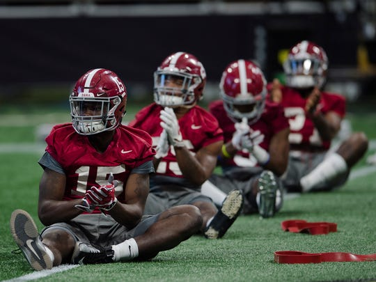 Alabama defensive back Ronnie Harrison (15) stretches during practice on Saturday, Jan. 6, 2018, at the Mercedes-Benz Stadium in Atlanta, Ga., for the National Championship NCAA football game.