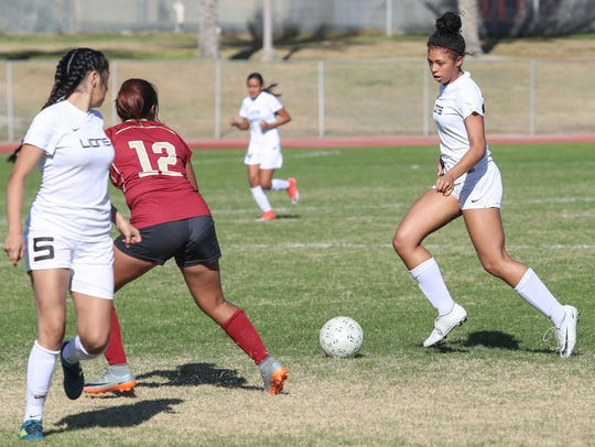 Azalea Guanajuato of Cathedral City High School dribbles