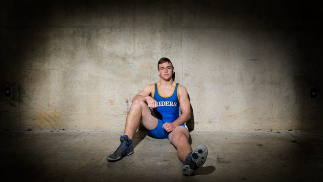 Caesar Rodney's Michael Clavier poses for a portrait at the Bob Carpenter Center at the University of Delaware following his seventh place finish in the 195-pound class at the Beast of the East on Sunday afternoon.