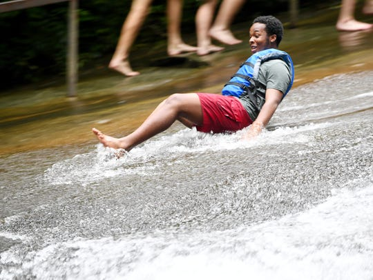 Caleb Jenkins goes down Sliding Rock in the Pisgah
