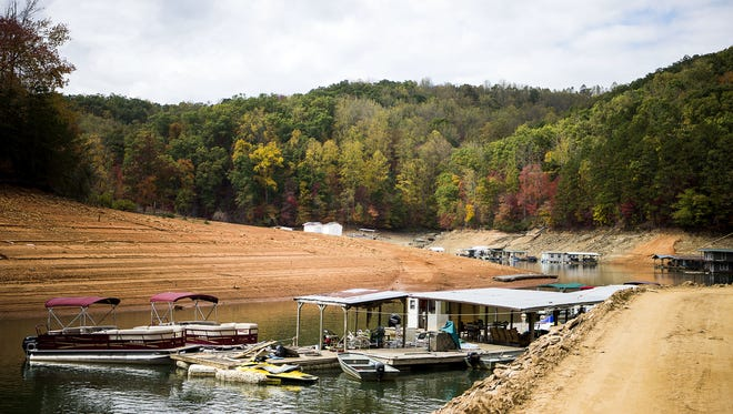 Empty houseboats float on the low waters of Fontana Lake at Alarka Boat Dock in October.