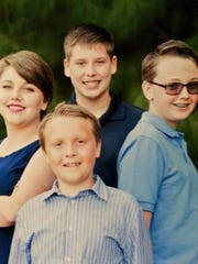 Zachary Polsenberg, top center, with, clockwise, stepbrother Conner, stepbrother Nicholas and sister Vanessa.
