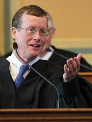 Iowa Supreme Court Justice Edward Mansfield speaks after taking the oath of office in 2011.