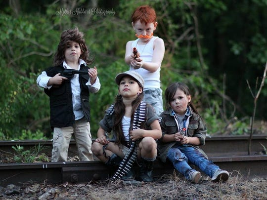 "Kids portray Eugene, Rosita, Abraham, and Tara from ""The Walking Dead."""
