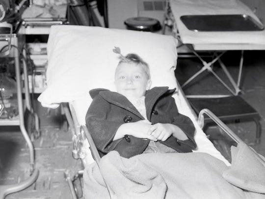 Bruce, age 6, was photographed with a dart in his head in the 1950s. This image was shared by the Springfield Police Museum on Monday.