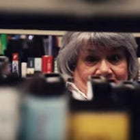 "A screenshot from the Livonia library promo video taken right before library director Toni LaPorte ""breaks through"" shelves of books in the library."