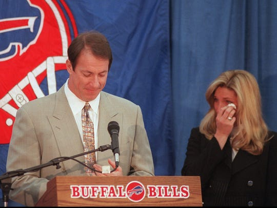 Buffalo Bills quarterback Jim Kelly, and his wife Jill, both break down as Kelly announces his retirement from the Bills at a news conference at Orchard Park on Jan. 31, 1997.