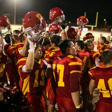 The Seton Catholic Sentinels celebrate the team's 35-24 home victory over the Estrella Foothills Wolves on Friday, Aug. 29, 2014, in Chandler, Ariz.