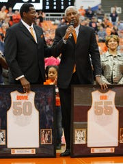 Syracuse basketball greats Roosevelt Bouie, left, and Louis Orr, right, thank the crowd during a ceremony where their jerseys were retired during halftime Saturday, Feb. 21, 2015.