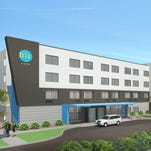 A rendering of the exterior of a Tru by Hilton, a new midscale hotel brand that will debut at the end of 2016.