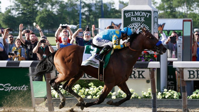 American Pharoah (5) with Victor Espinoza up crosses the finish line to win the 147th running of the Belmont Stakes horse race at Belmont Park, Saturday, June 6, 2015, in Elmont, N.Y. American Pharoah is the first horse to win the Triple Crown since Affirmed won it in 1978. (AP Photo/Seth Wenig)