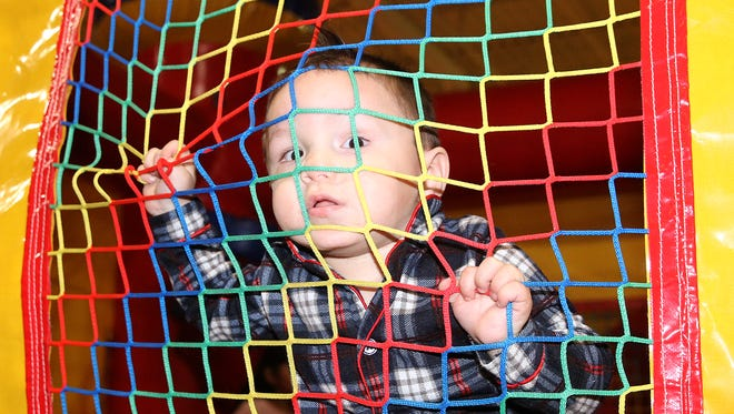 Gordon DeSpain V, 1, plays at the Big Bounce on Wednesday at the Animas Valley Mall.