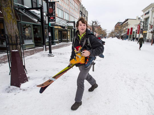 Nick Pattis of Brandon heads out of the Outdoor Gear Exchange with new skis in sub-zero temperatures in Burlington on Friday, January 5, 2018.