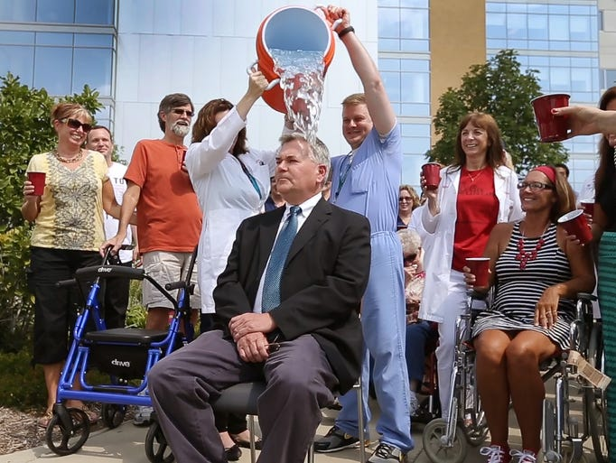 Dr. Robert Pascuzzi, IU neurologist and ALS researcher, took the ALS Ice Bucket Challenge Tuesday, August 19, 2014, afternoon as his patients and co-worker doused him with ice water.