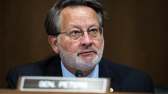 """Sen. Gary Peters, D-Mich., listens during a Senate Homeland Security and Governmental Affairs Committee hearing titled """"CBP Oversight: Examining the Evolving Challenges Facing the Agency,"""" Thursday, June 25, 2020 on Capitol Hill in Washington."""