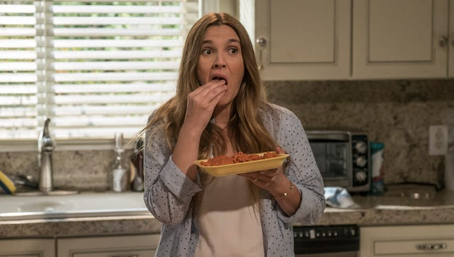 Sheila (Drew Barrymore) first tries raw hamburger, but it doesn't quite do the trick in Netflix's 'Santa Clarita Diet.'