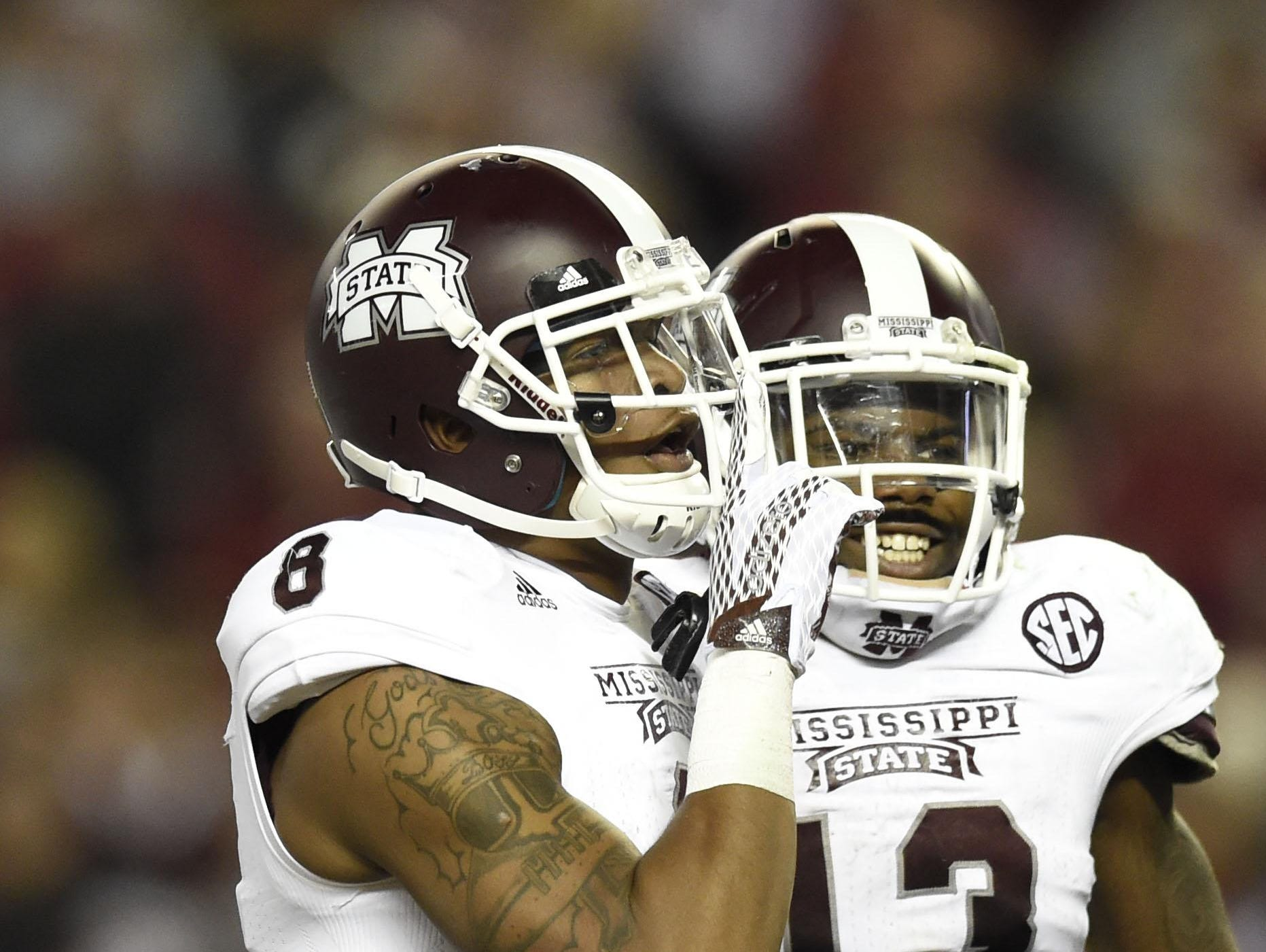 Mississippi State wide receiver Fred Ross (8) and former Bulldog Josh Robinson celebrate last year on the road in Alabama.